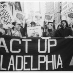 Photograph of an ACT UP Philadelphia parade group, with banner