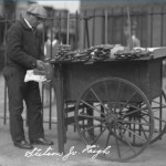 photograph os a man with pretzel cart