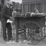 photograph os a man with pretzel cart