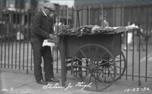 man with pretzel cart preparing for customers