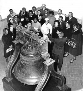 photograph of a group observing the Liberty Bell