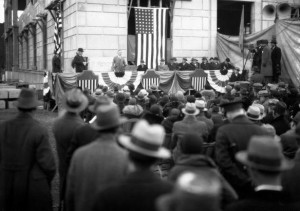 photo of a crowd gathered for the laying of the cornerstone of the school district's administration building