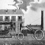 photograph of a steam engine pulling railroad cars that resemble horse-drawn buggies