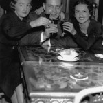 photograph of a man and two women toasting to the end of Prohibition