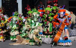 Photograph of a mummer band dressed in full costume
