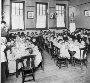 One of the most fundamentally important services offered by settlement houses like the Young Women's Union was childcare. In this photograph from around 1900, women provide meal service to a room full of young Jewish immigrants around 1900. (Special Collections Research Center, Temple University Libraries)