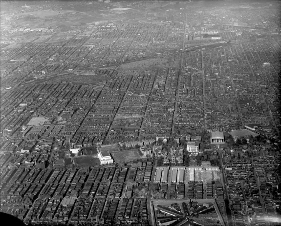A black and white aerial photograph of North Philadelphia. About thirty city blocks are visible in the image, with many of the row houses blending together.