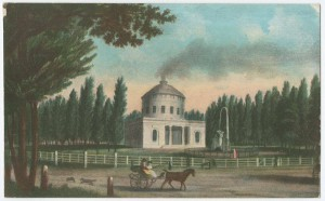 A color drawing of the Center Square, which at this time was only a white water pump building with steam coming out of the chimney. The rest of the square is lined with green trees. The image also shows a horse and carriage on a trail, and some white fence posts.