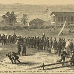 A black and white drawing of a group of people observing a baseball game in an open field. The players are in the middle, and the crowd is surrounding the players. There is a house and a few trees in the background. The players are wearing uniforms and the observers are watching