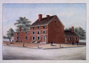 A color drawing of a building on the corner of a city block. The three story red brick home with black roof tiles is on the corner, and is connected to a two story addition to the left of the image and a one story building section to the right. There are some trees in the background and a about ten people walking along the sidewalk in front of the house.