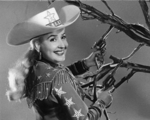 black and white photograph of Sally Starr in full cowgirl costume