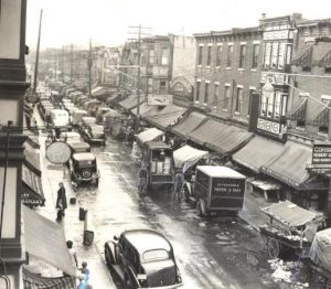 Jewish commercial districts like the pushcart market on Marshall Street in Northern Liberties,  shown here in the 1930s, emerged with the new wave of  immigration in the late nineteenth and early twentieth centuries. (Historical Society of  Pennsylvania)