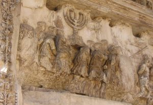 In Rome on the Triumphal Arch of Titus, which was built in 82 C.E. there is a relief depicting Titus's army with the plunder from the Temple in Jerusalem which they destroyed in 70 C.E. A menorah is prominently displayed among the spoils. (Wikimedia Commons)