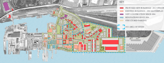 A map of the future construction of the Navy Yard, on top of a satellite image of the navy yard. The map portion shows colored sections of buildings, trees, and roads in various states of development. The satellite view is black and white, but shows more details of the buildings and roads.