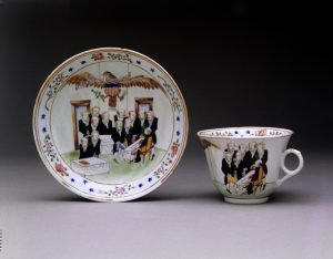 Photograph of a plate and teacup.