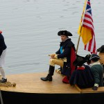 color photograph of a group of reenactors portraying Washington and his men crossing the Delware
