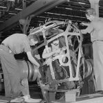 Photograph of workers in a bomb assembly plant.