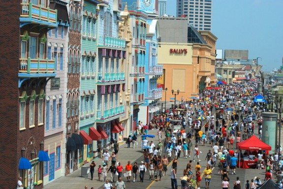 color photograph of Atlantic City Boardwalk with Bally's casino visible in background and air show crowds on the boardwalk.