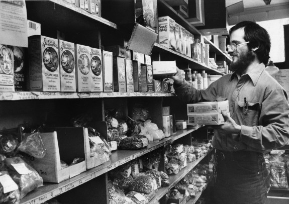 A manager stocks the shelves at Weaver's Way Co-op