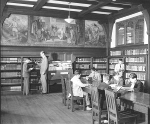 black and white photo of library with students and a teacher at Chestnut Hill Academy, c 1956