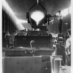 A black and white image of workers pouring molten metal into a mold at the Baldwin Locomotive Plants