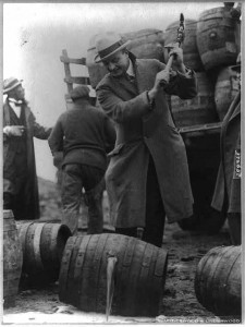 General Smedley Butler destroying a keg of beer with an axe
