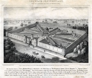 A newspaper clipping that shows an aerial sketch of eastern state penitentiary from 1856. Seven cellblocks radiate out from a central hub, and a thirty foot, castle-like wall surrounds the entire 10 acre site