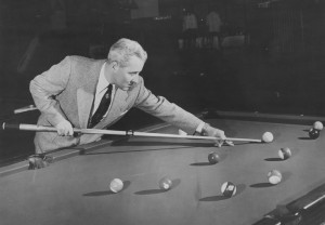 Williw Mosconi playing billiards.