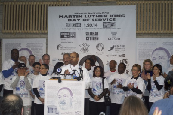 A color photograph of Philadelphia mayor Michael Nutter speaking at a podium with a small crowd of people standing around him.