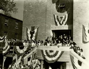 Photograph taken during the dedication of the Holy Redeemer Church, the image shows a strong turnout for the event.