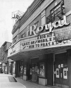 Photograph of the exterior of the Royal Theater, showing the marquee for the last show, as well as a for sale sign