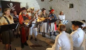 Color photo of the Sea Dogs singing shanties at the annual pirate weekend at Fort Mifflin, Philadelphia.