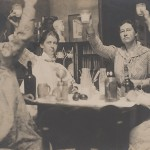 Photograph of four women raising glasses in a toast