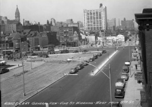 a black and white photo of Vine Street in the process of being widened