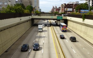 Color photo of traffic moving in both directions on the Vine Street Expressway one afternoon in mid-September 2015.