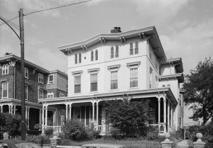 A black and white photo of an Italianate twin mansion built as part of Woodland Terrace, West Philadelphia.