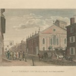 a color lithograph of the new lutheran church. from a vantage point across the street and a half block away. In the foreground, horses pull carts down the street and several men, both European Americans and Native Americans, walk together in a large group down the sidewalk.