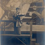 Photograph of artist with mural