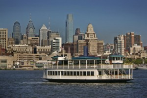A color photograph of the RiverLink ferry in front of the Philadelphia skyline