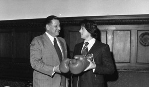 A black and white photo of Mayor Frank Rizzo and Sylvester Stallone holding boxing gloves