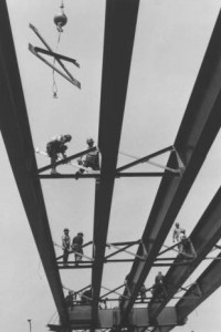 Steel workers constructing steel girters for the Betsy Ross Bridge.