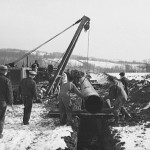 Workers lacing a piece of pipe for the War Emergency Pipeline