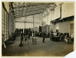 a sepia tone photograph of Lubinville studio showing glass ceiling and several active sets