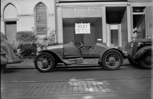 "A ""Jalopy,"" or an old car in poor condition on Pine Street in the late 1930s."