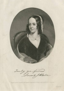 Portrait of Sarah Josepha Hale. She is seated in a chair and the image depicts her from the waist up. Her hair is dark and shoulder length and she wears a dark dress and a light colored piece of lace scarf on her head.