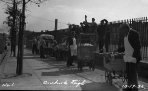 Vendors waiting outside of Overbrook High School in 1934.