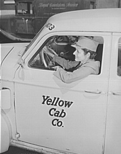 Mrs. Suzanne O'Donnell driving a Yellow Cab Co. Taxi in Philadelphia.