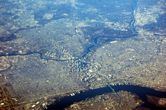 aerial photograph showing Center City Phila and environs, with the Delaware River near bottom of image and the Schuylkill River crussing across the middle, with Manayunk in upper right, West Philadelphia spreading from center to upper left,  and south philadelphia in the lower left quadrant.