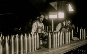 Men manufacturing ammunition for small arms and artillery.