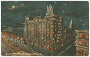 A color engraving of Broad Street station at night, showing the headhouse and